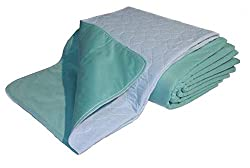 folded green and white mattress pad