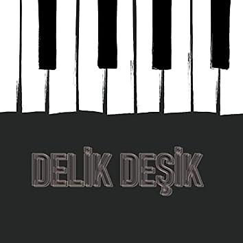 Delik Deşik (feat. Oly)