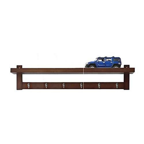 Aan de muur bevindt zich een creatief raster van planken, versierd met gepersonaliseerde kleerhangers om aan de muur te hangen zonder boren. size Vistoso