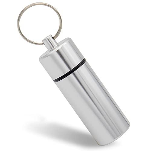 Aribari Mini pillerask i aluminium med nyckelring. Vattentät tablettlåda. Nödkapslar. Presentetiketter eller adressetiketter. Längd 6,8 cm ø 2,2 cm. Silver