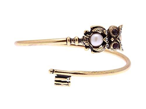 Pulsera rígida de latón con llave con búho Alcozer granate Swarovski y una perla central