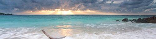 Wallario Küchenrückwand Hartschaumplatte, Größe 200 x 50 cm, Motiv: Wellen am Strand bei Sonnenuntergang
