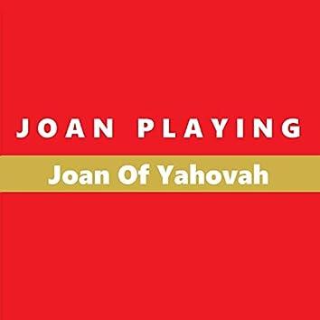 Joan Playing