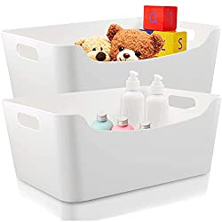 2 white plastic organizing bins filled with toys and bottles