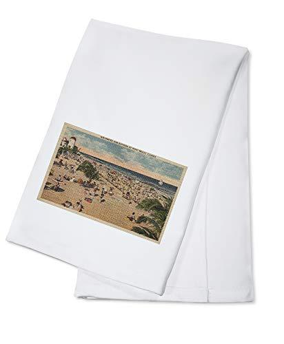 Lantern Press Miami, Florida - View of Sunbathers at Miami Beach (100% Cotton Kitchen Towel)
