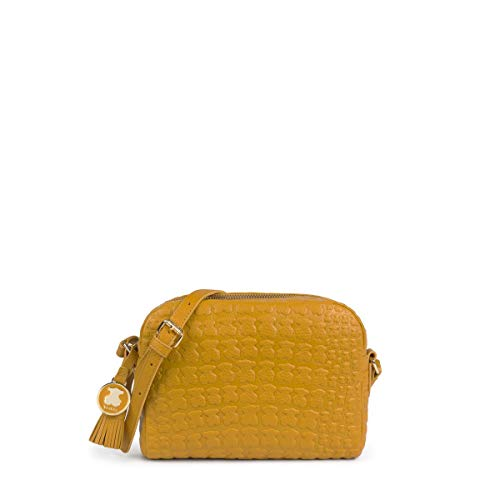 TOUS crossbody bag Sherton collection in mustard leather engraved with bears Zipper closure. Personalized appliques in light gold Adjustable shoulder strap. One interior pocket with zipper and one without zipper Measurements: 14x19x2 cm.