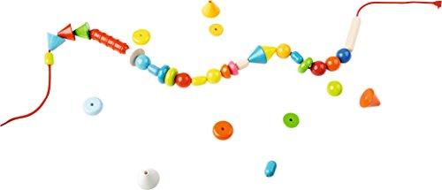 HABA 302637 - Fädelspiel Regenbogenperlen | Kreatives Fädelspielzeug mit 66 Perlen zum Auffädeln in unterschiedlichen Farben und Formen  | Spielzeug ab 3 Jahren