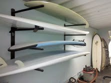 T-Rax SUP 4 Board Wall Rack 2 SUP 4 board storage wall rack. Extremely heavy duty! Lifetime guarantee. Made in the U.S.A. All stainless steel hardware included. High quality UV rated foam padding.
