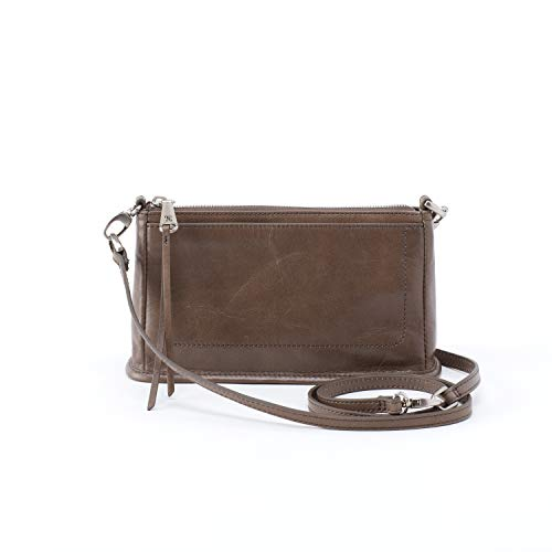 The Hobo® Cadence is the quintessential go-to bag! Perfect for day to night wear, this purse converts from crossbody to clutch with ease. Crossbody made of leather. Top zip closure. Removable crossbody strap. Tassel detail on zipper pull. Exterior sl...
