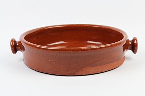 Tegame in terracotta, fatto a mano tradizionalmente. Misure esterne con manici 32 cm diametro interno 28 cm diametro 7 cm altezza completamente artigianale
