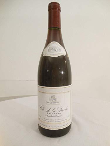 clos de la roche patriarche grand cru le bastion des dames grand cru rouge 1992 - bourgogne france: une bouteille de vin.