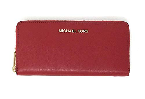 """Zip around closure. Michael Kors logo lettering across the front Interior: Logo lining; zip coin compartment, (8) credit card slots, bill compartments and multifunction slip pockets. Approximate measurements: 8""""L x 4""""H x 0.75""""D."""