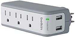 A white Belkin travel surge protector.