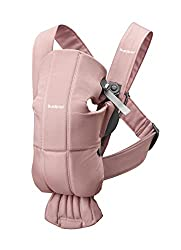 A minimalist baby carrier in blush pink