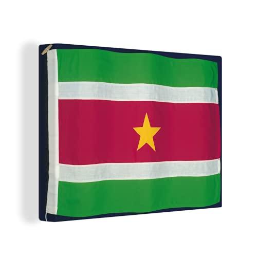 Leinwandbild - Die Flagge von Suriname auf einem schwarzen Hintergr& - 120x90 cm