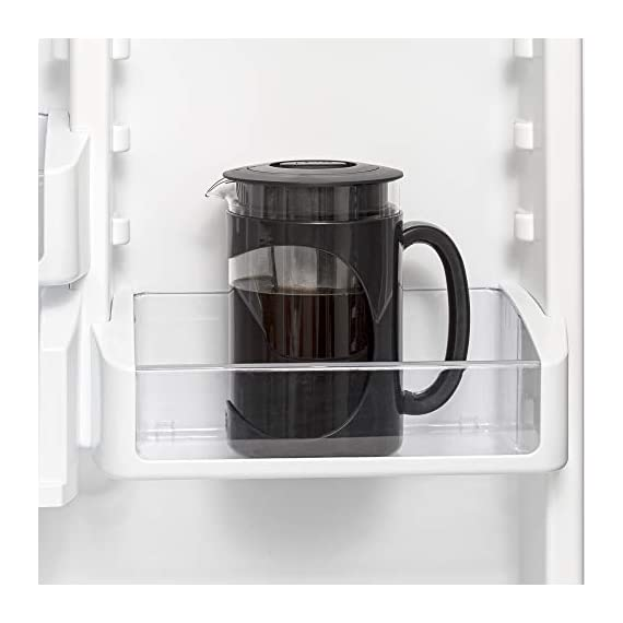 Iced Coffee Maker, Comfort Grip Handle, Durable Glass Carafe, Removable Mesh Filter, Perfect 6 Cup Size, Dishwasher Safe… 4 BETTER BREWING - Enjoy smooth, delicious cold brew coffee at home. Also great for iced tea and infused beverages. The high quality keeps your beverage fresh for days! EASY-TO-USE - Brew, store and serve all in one. A simple four step process: 1) Simply add coffee grounds to brew filter, 2) Pour cold water over coffee, 3) Brew in the refrigerator overnight 4) Serve and enjoy! INNOVATIVE DESIGN - Made of temperature safe borosilicate glass with a durable protective holder and comfortable grip handle. Specially designed lid seals in freshness for days and provides a smooth, drip-free pour. Fine mesh coffee filter keeps grounds out of your coffee. Non-slip silicone base protects the glass from accidental slips.