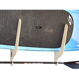 """The Harbor SUP Paddle Board Wall Storage Rack 1 32"""" wide. 26"""" top to bottom. 15"""" deep (distance it sticks out from wall). Holds SUPs, paddles boards, shortboards, longboards, etc! Precision cut, beautiful baltic birch construction. Can hold up to 120 lbs Convenient accessories hook for paddles, wetsuits, helmets, gloves, etc"""