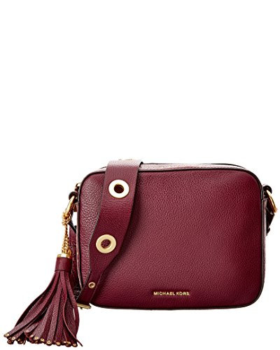 "leather with nylon lining cross-body-strap with strap drop of 23"" zipper Closure Dimensions: 9""W x 7""H x 2.75""D"