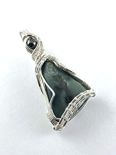 Magnetite gemstone pendant with Hematite wire wrapped in fine silver. An Essential Tool For Energy Healers