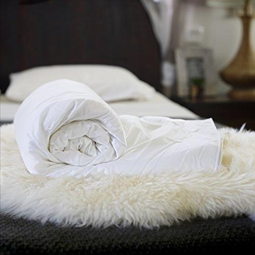 Silk Bedding Direct SILK-FILLED DUVET. Cot Size. Spring/Autumn (10 Tog) Hand-Finished, Long-Strand Mulberry Silk. Hypoallergenic. 150cm x 120cm / 59' x 47'. OEKO-TEX Standard 100 Certification.