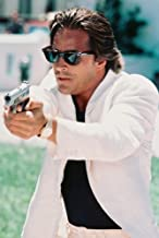 Don Johnson Miami Vice cool in pose in white jacket pointing gun 24X36 Poster