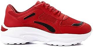 أحذية رياضية نسائية من الجلد الصناعي من Grinta ذات تفاصيل متباينة وكعب مكتنز