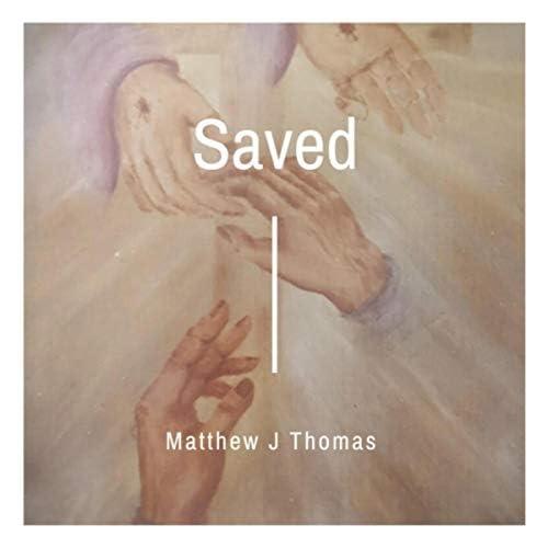 Matthew J. Thomas