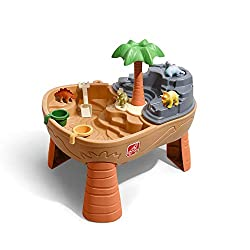 "Two-sided table features an area for sand and an area for water Pour water into the top of the ""volcano"", and watch as the water gusts down the Ash Mountain for a water eruption! The dinosaurs can get some shade and take a drink from the local wateri..."