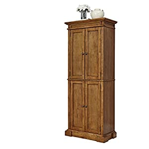 Made of hardwood solids and veneers. Features include Diamond shaped carving details at the Top, Handsome Raised wood panel doors and adjustable shelves to accommodate large items Comes with multi step Distressed Oak Finish Assembly required. Measure...