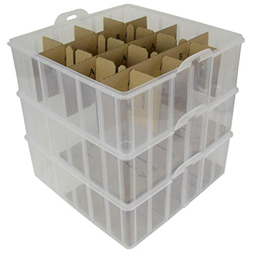 plastic ornament storage box empty with the lid off.  cardboard inserts seen inside the box.