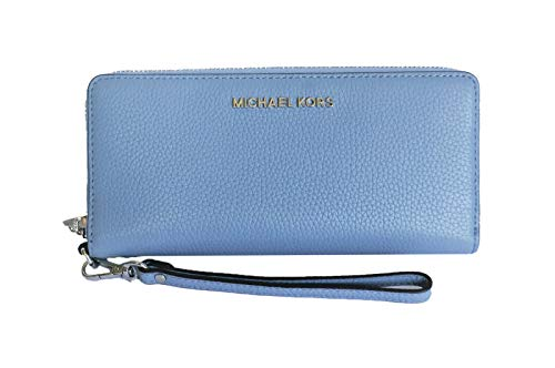 "Travel glamorously with the Jet Set Continental zip-around wallet by Michael Kors Full zip around closure, Saffiano Leather/Polyester Fabric Lining Features crossgrain leather, classic gold-tone hardware, and detachable wristlet strap Width: 8.25"", L..."