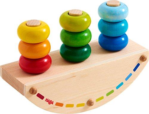 HABA 303228 - Steckspiel Regenbogen-Schaukel | Holzspielzeug aus Wippe, 3 Stäben und 9 bunten Ringen zum Zusammenstecken | Spielzeug ab 18 Monaten