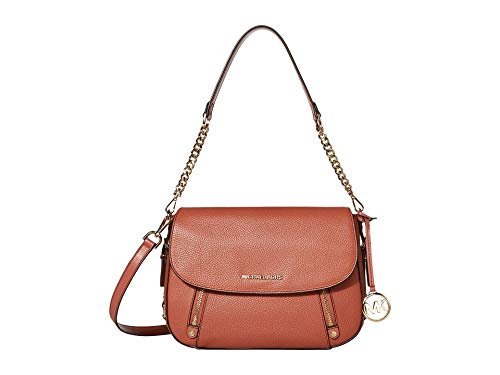Made of Leather; Flap closure; Polyester lining; 1 interior zip pocket and 1 slip pocket 1 exterior back snap pocket and 1 front zip pocket; 8.5 Inches handle Adjustable strap of 20.5-22 Inches; Gold tone hardware Measurements: Length: 11.5 x Height:...