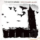Songtexte von The War on Drugs - Wagonwheel Blues