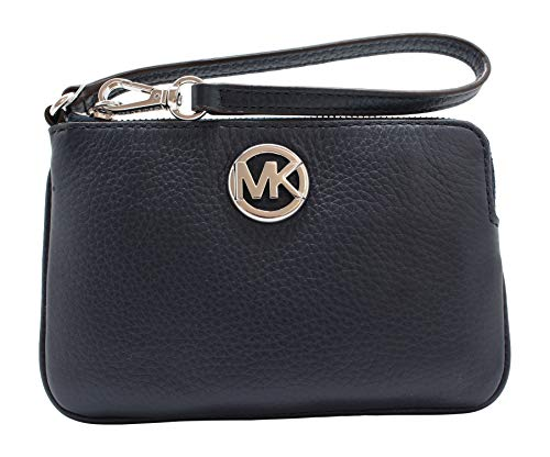 """Pebble leather with silver tone hardware. Approximate measurement: 6"""" (L) x 4"""" (H) x .5"""" (W) 3 Credit Card Slots Top zip around closure. Imported"""