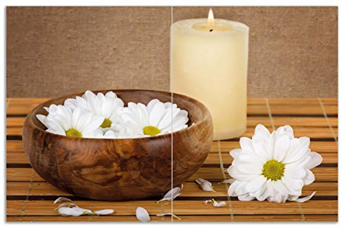 Wallario Herdabdeckplatte/Spritzschutz aus Glas, 2-teilig, 80x52cm, für Ceran- und Induktionsherde, Motiv Stillleben - Kerzen und Blumenblüten in Holzschale