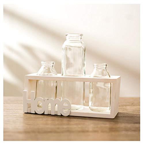 Glazen fles met transparante vaas en houten frame voor op het bureau, creatief huis, tuin, café, kamerdecoratie