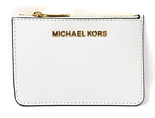 Slim saffiano finished leather coin pouch and ID holder with polished golden tone hardware Zip top compartment with card slip and a tethered split key ring inside Accented with Michael Kors logo across the front Back offers a clear ID slot, (2) card ...
