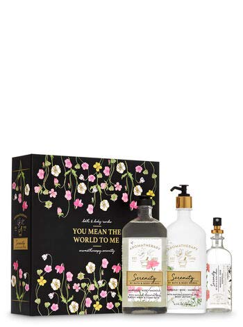 Bath and Body Works Aromatherapy Serenity MARIGOLD ROSE MAGNOLIA Gift Box Set - Body Lotion - Shower Gel Foam Bath and Pillow Mist in a floral gift box with a coordinating ribbon.