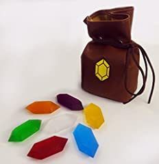 Set of 7 resin Rupees inspired by the Legend of Zelda series The set includes one of each color: green, blue, yellow, red, purple, orange and silver(white) One handmade synthetic leather rupee wallet