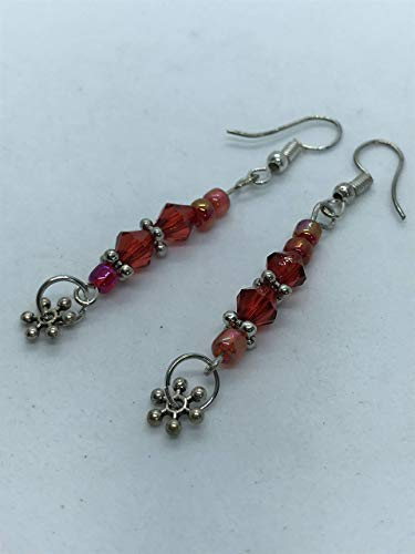 Red and silver metal earrings by Susan Craker