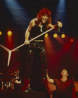 Jon Bon Jovi iconic 1980's on stage in concert holding mike stand 16x20 Poster