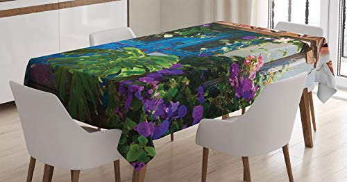 Rustic Decorations Tablecloth by Ambesonne, Charm of Old Door with Overgrown Exotic Flower Petals and Palm Leaves Scene, Dining Room Kitchen Rectangular Table Cover, 52W X 70L Inches, Multi