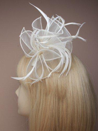 Crystal Innovation ref- 8321- Grand Crème à tissu et plumes sur un peigne clair.