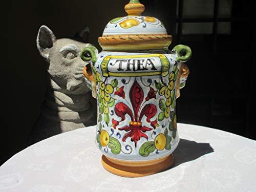 Tarro de cerámica hecho a mano y pintado a mano en una forma muy antigua, llamado albarello como contenedor de farmacia típico en un diseño tradicional toscano con símbolo de la ciudad de Florencia
