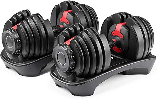 552 - Two Adjustable Dumbbells. adjusts from 5 to 52.5 pounds