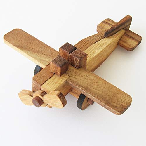 AVION - Gioco rottura testa a partire dai 7 anni in legno massiccio, norme CE. Difficoltà 2/6 marca francese Le Délirant, un puzzle da 9 pezzi da smontare e assemblare, soluzione fornita in francese.