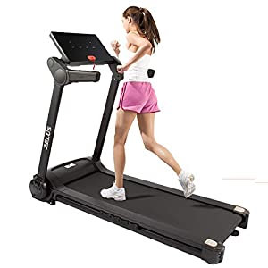 woman running on a zelus 2hp folding treadmill