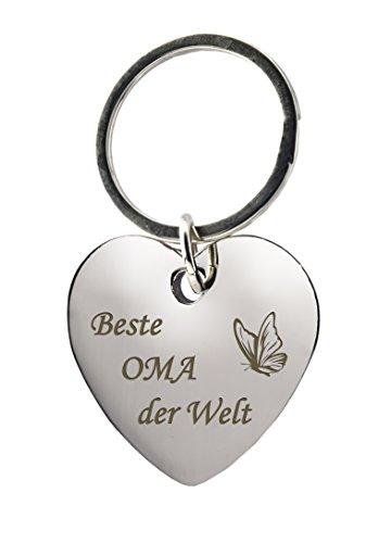 GESCHENKE-FABRIK Schlüsselanhänger - Herz mit Gravur 'Beste Oma der Welt' mit Schmetterling - Metall im Chrom Stil - Geschenk zum Muttertag oder als Geschenk für Omas für jeden Anlass