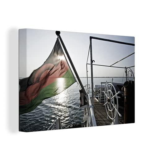 Leinwandbild - Die Flagge von Malawi auf einem Boot - 150x100 cm